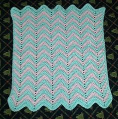 """Preemie or Newborn SC Ripple Afghan  This is a great afghan in 2 sizes - a 15 X 17"""" preemie version & a 30 X 34"""" newborn version.   It works well for preemies, because there aren't large holes to snag fingers and toes!  Materials: Soft WW Yarn -- 4(8) oz, Color A, 3(7) oz color B; Size I crochet hook"""