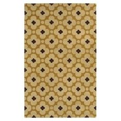 Hand-tufted wool rug with a quatrefoil motif.  Product: RugConstruction Material: 100% WoolColor: Light goldFeatures: Hand-tuftedNote: Please be aware that actual colors may vary from those shown on your screen. Accent rugs may also not show the entire pattern that the corresponding area rugs have.Cleaning and Care: Vacuum and spot clean as needed.  Do not use a beater bar.