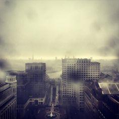 Doom and gloom. #london #skyline #canarywharf #rain #clouds #view #onecanadasquare #foryou by arjanstulen