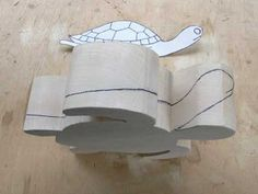 Draw the height of the flippers and the shape of the head onto the sides of the work