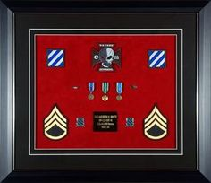Framed military medals and ribbons in custom shadow boxes and display cases | examples of completed military medal and ribbon displays | Framed Guidons