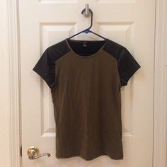 Olive shirt with faux leather sleeves Great shirt, stretchy material! Like new. Not from Urban Outfitters. Urban Outfitters Tops Tees - Short Sleeve