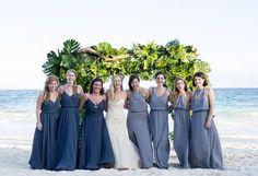 These bridesmaids dresses and navy/gray color palette are stunning! These are such great colors for a beach wedding.