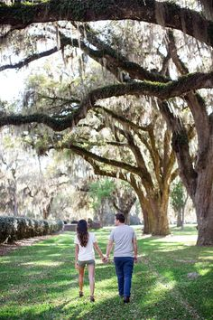 Strolling under glistening moss at The Ford Plantation. Swoon! See more on Savannah Soiree. http://www.savannahsoiree.com/journal/engagement-session-at-the-ford-plantation