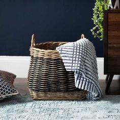 This Melanie Round Belly Wicker Basket features a mix of wicker and natural materials. It's a perfect catch-all in your entryway or accent in your living room. Kirkland Store, Decorative Pillows, Decorative Boxes, Belly Basket, Holly Springs, Johnson City, Large Baskets, Storage Boxes, Home Organization