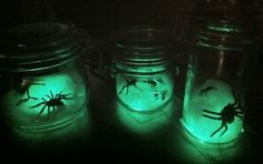 Glow stick or bracelet in jar. Pull apart cotton over top and place spiders.