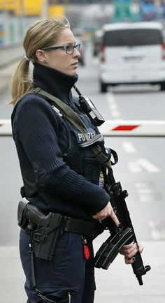 German police officer guard the driveway to the airport in Frankfurt, Germany, during tighter security measures Tuesday, March when various explosions hit the the Belgian capital Brussels killing several people. Female Police Officers, Police Officer Uniform, German Police, Female Soldier, Army Soldier, Military Women, Military Female, Military Girl, Warrior Girl