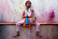 A boy holding a spray bottle takes part in the religious festival of Holi inside a temple in Nandgaon village in the state of Uttar Pradesh, India, on March Justin Trudeau, Holi, Indiana, Evil Demons, End Of Winter, Women Laughing, Hindu Festivals, Face Pictures, Winter Festival