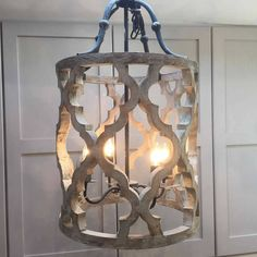 Cowshed Interiors Carved Wood And Metal Ikat Design Pendant Chandelier ($425) ❤ liked on Polyvore featuring home, lighting, ceiling lights, wooden chandeliers, metal hanging lamp, wooden lighting, metal lighting and wood lighting