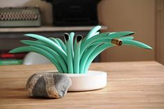 Table top plant made out of garden hose