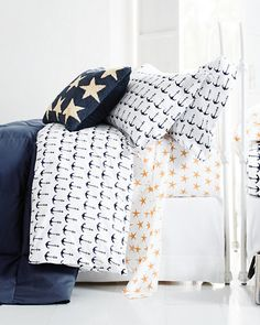 Crisp cotton percale sheets in fun nautical motifs are a great way to update your bedroom for summer.