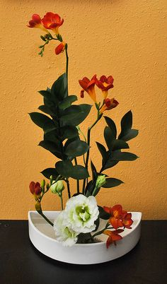 Freesia Ikebana in bloom by tokyofortwo, via Flickr