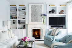 Get the Look: Cool Blue Fireplace >> http://photos.hgtv.com/rooms/viewer/living-space/cool-blue-living-room-with-marble-fireplace?soc=pinterest?soc=pinterest