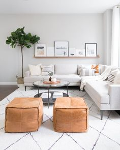 How to decorate a minimalist living room + sharing our living room furniture sources! Neutral gray modern sectional, leather poufs, wood art ledge, faux fiddle leaf fig, and moroccan rug. #livingroom Modern Minimalist Living Room, Minimal Living, Living Room Modern, Living Room Designs, Living Room Ideas 2020, Minimalist Living Room Furniture, Modern Furniture, Furniture Design, Plywood Furniture