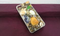 Check out this item in my Etsy shop https://www.etsy.com/listing/224375182/iphone-55s-seashell-phone-casebeach