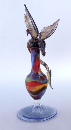 A flame with desire - Blown art glass landscape bottle and flying dragon via flickr.com💗