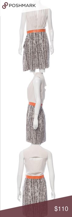 "⭐️ Sachin + Babi Cream and Black Mix Media Dress Cream bodice cream and black reptile print skirt with orange leather waistband. Pleated surplice neckline with back cut out Accent. Invisible side zipper closure.   Body: 100% Polyester   Contrast: 100% Polyester   Trim: 100% Leather   Dry Clean Only   37"" Bust  31"" Waist  40"" Hips  36"" Length  Cream and Snake Print Sachin + Babi Sleeveless Dress Sachin + Babi Dresses Asymmetrical"