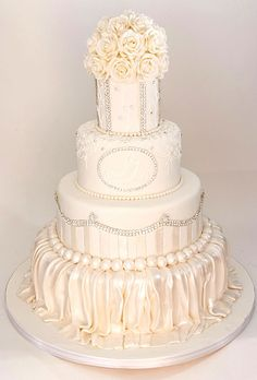 A White Wedding Cake by Cake Boss Buddy Valastro. To win your own celebrity-style wedding cake plus so much more, visit facebook.com/BridesLiveWedding