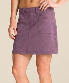 This mid-rise skort showcases a flattering wide waistband and streamlined silhouette it's sure to flatter all figures. Featuring a breezy fabric and plenty of pockets, this breathable piece offers superior style.
