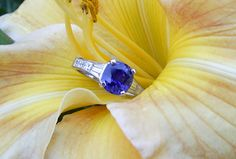 Sapphire: 3.29ct, unheated Pailin, color-change, cushion cut Diamonds: approx. 1ctw, 2 tapered baguettes and 3 square step cuts on each side 18k white gold