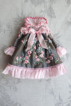 https://flic.kr/p/dUkbA7 | For Jessica ≈ Stormy Roses ≈ | This dress was cut in a beautiful blue-grey silk fabric, a subtle brocade, revealing large tulips, and entirely embroidered with garlands of silk ribbon roses. The bust was covered with pink lace, before beeing embroidered. The balloon sleeves in a dotted swiss fabric are terminated by a batiste flounce, the same flounce also forms the collar and the bottom of the dress... Thin pink lace, some beads and a large front bow finish to…