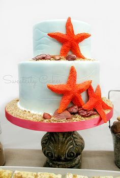 Sweet Beach engagement cake with edible starfish and shells http://sweetcitydesignercakes.weebly.com/cake-gallery.html