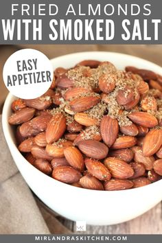 These tasty fried almonds are a easy and delicious appetizer! Toss them with some smoked sea salt for amazing results. Serve at BBQs, take hiking, bring them to a football party - this is a great all occasion party food! #partyfood #appetizer #nuts #easy #seasalt Tostadas, Snack Recipes, Cooking Recipes, Snack Hacks, Appetizer Recipes, Healthy Snacks, Healthy Recipes, Delicious Recipes, Good Food