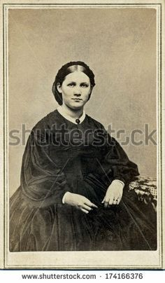 USA - CONNECTICUT - CIRCA 1865 - A vintage Cartes de visite photo of young pioneer woman sitting in chair. She is dressed in hoop skirt dress. Photo from the Civil War Victorian era. CIRCA 1865