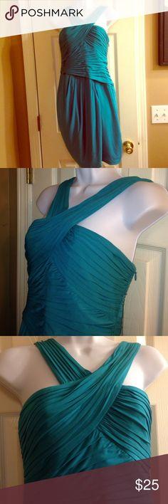 Beautiful BCBG turquoise elegant dress size medium Beautiful BCBG turquoise elegant dress size medium. Great condition!!! BCBG Dresses Midi