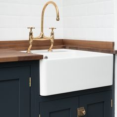 Our gorgeous aged brass tap in the Balham project utility room