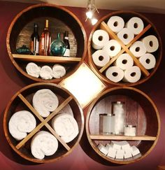 Cute bathroom storage!!! Barrel cut into sections and hung on the wall for a unique looking shelf in the bathroom.