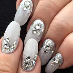CND Co-Founder Jan Arnold's nails are a dream! This dazzling look was created with RETENTION+® Liquid & Powder, CND® SHELLAC® brand 14+ day nail color in Studio White, holographic foil & embellishments by CND Education Ambassador, John Nguyen!