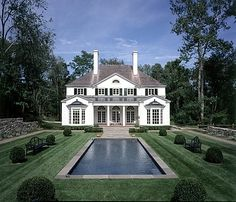 White house with lap pool - backyard