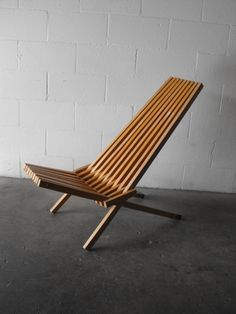 Folding Slatted Wooden Chair      (http://www.amsterdammodern.com/search-product/1908-FOLDING-SLATTED-WOOD-CHAIR?s=folding)