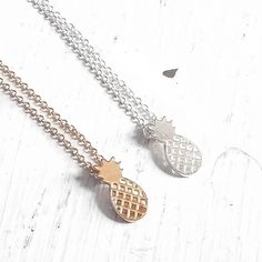 """• Pineapple Necklaces • If you you like pina coladas...  These gorgeous 18k gold plated and silver pineapple necklaces come in silver and gold tones. Stainless steel material, will not tarnish (yay!) Lead + nickel free. 16.8"""" length   ↓Follow me on Instagram ↓         @ love.jen.marie Jennifer's Chic Boutique Jewelry Necklaces"""