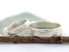 LOVE the texture and uniqueness of these wedding bands, but still simple. Perfection.