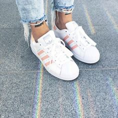 White and pink adidas superstar sneakers