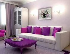 Living Room - Pretty purple accents and that purple coffee table!