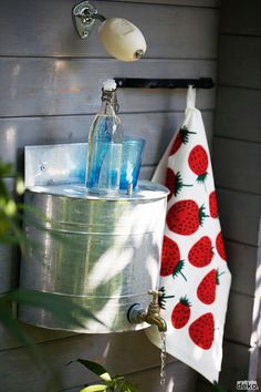 hand washing  love this idea for outside. if you could get some rain water in here..... love the soap!!!!!!