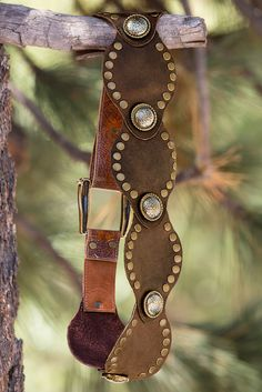 """Finishing your boho look is a cinch with this supple leather hip belt with rustic hammered medallions. Loop peg closure.• By Leatherock.• Cow leather/metal.• Imported.• 3 1/2"""" widest; 1 1/2"""" buckle strap width.• Sizes XS(30""""), S(32""""), M(34""""), L(36""""), XL(38"""")."""