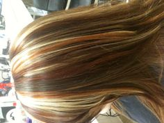 Tri colored highlights, red, copper and blonde. Stylist Wendy brown