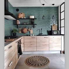 The texture of the wood cabinets against the lines of the green tile backsplash. This kitchen does balance right! ( The texture of the wood cabinets against the lines of the green tile backsplash. This kitchen does balance right! Home Decor Kitchen, Interior Design Kitchen, New Kitchen, Home Kitchens, Bohemian Kitchen Decor, Bohemian Interior, Wooden Kitchen, Interior Walls, Wall Tiles For Kitchen
