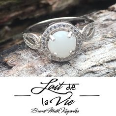 Brand new sterling silver breast milk ring. Turn your breast milk in to beautiful breast milk jewelry.   Sterling silver and cubic zirconia halo infinity ring  Www.laitdelavie.com