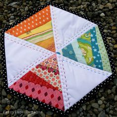 #hexagon mug rug  - look at those tiny strips!