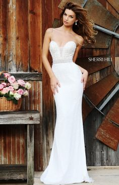 We dare you to find us a gown that is more elegant, beautiful and classic as this stunning Sherri Hill 11260 dress. We are loving the lovely lace upper bodice with modesty panel and pearl beaded waistline. The thin straps on this dress lead to the back of the dress and a back zipper closure. The skirt of this gown is made of gorgeous beaded chiffon and it will sparkle all night long. This dress is ideal for a wedding, prom, formal gala or debutante ball.
