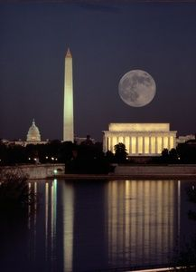 Moonrise over the Lincoln Memorial. The Washington Monument and Capitol are in the background.