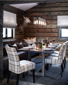 Modern rustic design, wood furnishings, plaid upholstered seating, wood wallcovering, pendant lighting- minus the taxidermy Cabin Homes, Log Homes, Chalet Design, Cabin Chic, Home Improvement Loans, Cabin Interiors, Cuisines Design, Bungalows, Home Kitchens