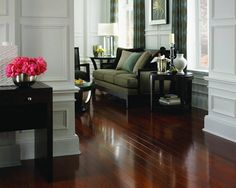 Get a luxurious hardwood look with laminate...yeah pretty deceiving eh? Create a similar look with Brazillian Cherry by Mannington: http://americasfloorsource.com/catalog/laminate/hardwood/brazilian-cherry-2012/samba-brown-16251