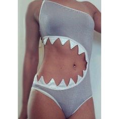 I wonder if the designer tried to make it look like a shark is eating the bather or they were actually trying to make a stylish swimsuit and chose white sharp points and a light grey color for the body...