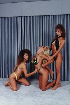 Two blonde bikini models Cindy and Candy getting punched in the belly and tits 2 on 1 style at Action Sports Productions in their early days